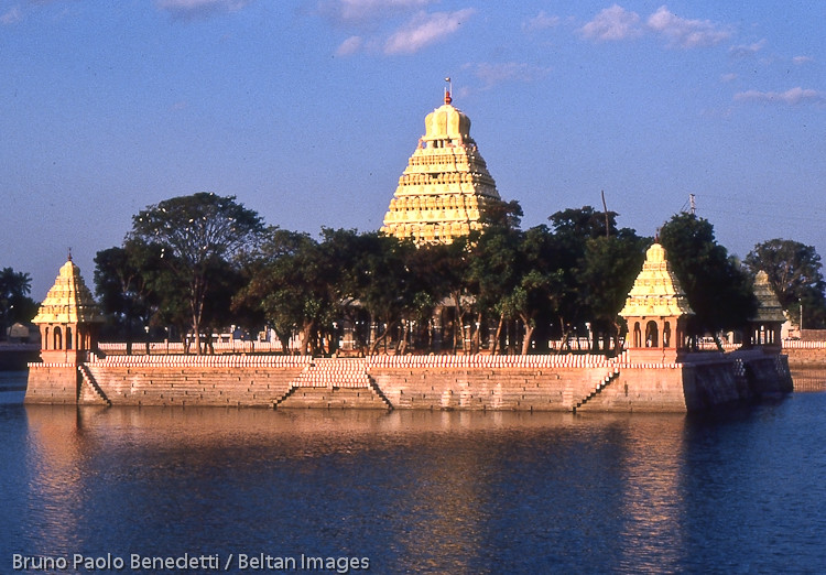 india landscape with gopuram temple at sunset.