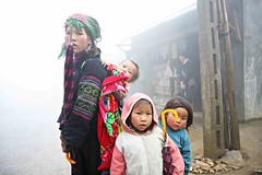 Family in the mist (★Clandestino) Tags: trip travel family portrait mist fog canon temple asia cambodia robe buddha south monk buddhism east vietnam backpack laos 70200 sapa hmong 1755 40d