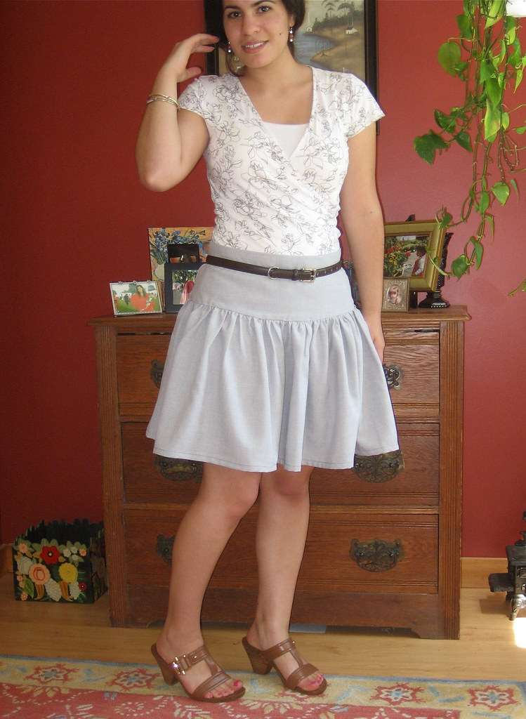 white floral print top, grey skirt, brown sandals, brown belt