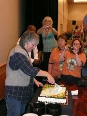 Meg Swanson cutting Elizabeth Zimmerman BD cake1