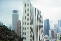 Buildings-by-the-Hill (Canadian Pacific) Tags: city urban buildings hongkong office realestate hill towers commercial round highrise residence 香港 residential cramped slope hongkongisland crowded wanchai 灣仔 hopewellcentre hopewellcenter notfortheclaustrophobic