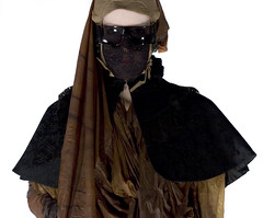 """""""ask it of them from behind a curtain"""" (Cyberoptix™) Tags: art fashion veil mask curtain hijab rubber cover spy modesty latex cloak conceptual protection doily espionage privacy capelet takingtheveil niqāb atmosphericpressures interpretationsofmodesty muhammadswife"""