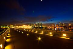 A City in the Twilight (KNL-17) Tags: buildings reflections lights twilight nikon singapore illumination d200 urbanlandscape marinabarrage sigma1020mmf456exhsmdc