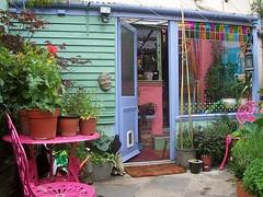 yard (Romany Soup) Tags: plants window yard glasspaintinggardenfurniturecolourful