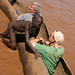Boy pushing Ty and Vern out onto the Omo River