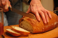 Cutting warm bread, at Q's party, Broadview Ne...