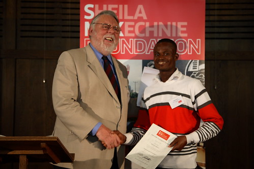 Raphael Ahenu receiving his award from Terry Waite