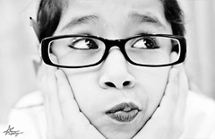 "a NERD! (""Anwaar) Tags: bw white black never cute nerd girl its portraits canon fun 50mm glasses kid am funny photographer sweet sister expression adorable just honey will be p haha kuwait lovely f18 kuwaiti dema 400d abigfave anwaar lifeinsevenpages"