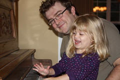 Catie playing piano with Daddy