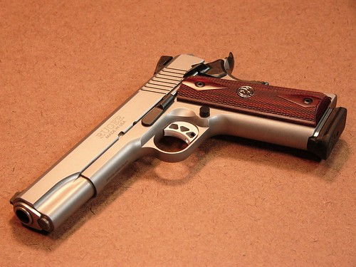 Left gun show w/ first 1911 in hand - 1911 Forum