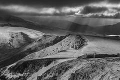 'Light Rays On The Ridge' - Moel Eilio, Snowdonia (Kristofer Williams) Tags: bw mono moeleilio wales snowdonia landscape mountains ridge rays light crepuscularrays winter snow atmosphere
