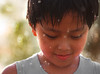 in the rain (alvin lamucho ©) Tags: park boy cute water rain garden droplets drops kid dof bokeh adorable handsome son telephoto jed raindrops kuwait depth waterdroplets goodlooking 200mm mahboula eldest abuhalifa canon450d alvinlamucho