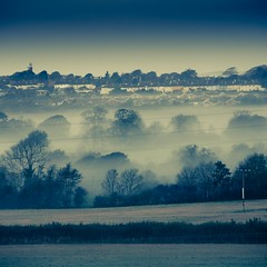 I walked the mist in blue. (photocillin) Tags: blue autumn trees houses winter mist fall wales wires fields layers monday telegraph pembrokeshire haverfordwest terace bluemonday