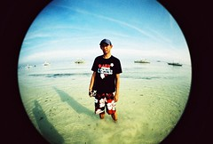 bj fishy portrait (darkcanopy) Tags: blue portrait people film beach analog fun xpro lomography crossprocessed kodak crossprocess philippines wide lofi slide fisheye bohol analogue fe ph elitechrome  lomograph panglao lowfi lsi  funshot fe2 fisheye2 xprod ebx lomographyfisheye 170degrees 170 lsifisheye elitechromeextracolors elitechromeextracolors100