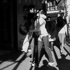 I Feel Love (Ian Brumpton) Tags: street uk england bw london blancoynegro square blackwhite noiretblanc candid streetphotography lovers leicestersquare amore biancoenero decisivemoment streetphotographer ifeellove londonstreetphotography lifeinslowmotion scattidistrada thebestdaysofyourlfe