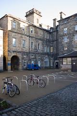 Former Surgical Hospital, Edinburgh (David_Leicafan) Tags: 28mmsummicron edinburgh universityofedinburgh davidbryce robertrowandanderson italianrenaissance hospital university bicycle pend tower courtyard