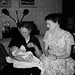 Grandma Juanita holding Paul with proud Mom at christening party