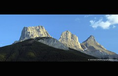Three Sisters, Canmore, Alberta (westrock-bob) Tags: blue trees summer sky sun white canada mountains green clouds sisters golden three amazing superb rocky bob ab hills adventure clear explore alberta hour threesisters setting canmore 2009 rugged allrightsreserved westrock splendid 3sisters kanada evergreeen kanata evning cuthill aplusphoto westrockbob bobcuthillphotographygmailcom