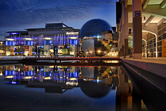 UK - Bristol - Millennium Square - Reflections at dusk (Darrell Godliman) Tags: city uk greatbritain travel england urban copyright reflection building travelling tourism architecture night buildings reflections bristol arquitectura nikon europe britishisles unitedkingdom britain dusk eu nightime gb scifi architektur planetarium bluehour d200 architettura europeanunion futuristic magichour allrightsreserved architectuur regeneration mimari millenniumsquare atbristol architecturalphotography contemporaryarchitecture travelphotography nikond200 instantfave omot  travelphotographer chriswilkinson flickrelite dgphotos darrellgodliman wwwdgphotoscouk architecturalphotographer dgodliman millenniumsq ukbristolmillenniumsquarereflectionsatdusk