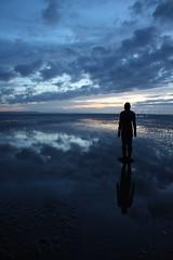 Another Place - Anthony Gormley 16 (Irish Wonderboy) Tags: sunset sea sculpture irish man reflection men art beach water silhouette liverpool sand publicart spiritual immigration indiansummer crosby anthonygormley migrants anotherplace emmigration lookingtothesea bestlighting