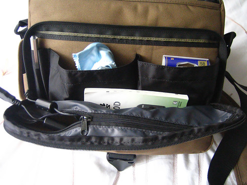 Inside the front zippered pocket: there are two open compartments which will fit cleaning gear, filters, etc, another zippered pocket to store other bits, and then the main compartment itself which can store whatever else you need!
