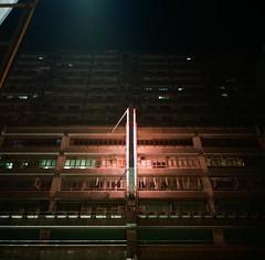 24-hr (kymak) Tags: street city building facade hongkong neon exterior box ad velvia  mongkok fujichrome rvp100f artificiallight 24hr f35 nathanroad 75mm  schneiderxenar3575 rolleiflex35a modelk4a automat6x6 mxtype2