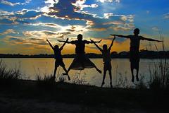 Joyz of Boyz (Tipu Kibria~~BUSY~~) Tags: boy sunset sky cute boys water kids clouds canon reflections river children fun happy eos evening kid village child joy innocent villagekids canonefs1785mmisusm xti 400d shudhuibanglahazratpurvromon