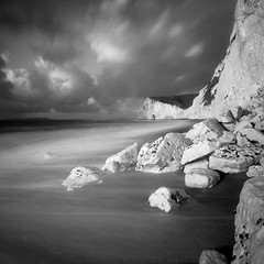 Bat's Head (Adam Clutterbuck) Tags: ocean door uk longexposure greatbritain sea england blackandwhite bw white seascape beach monochrome clouds square landscape mono coast blackwhite chalk cloudy unitedkingdom britain head cliffs bn coastal shore elements dorset gb bandw dor sq rockfall bats oe durdle durdledoor greengage adamclutterbuck batshead sqbw bwsq showinrecentset openedition