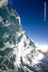 wave crashing onto beach, Hawaii (Sean Davey Photography) Tags: seawaveenergy seaswell greenpower oceanpower oceanenergy seawave wavesenergy oceanwavepictures oceanswell pictures wave oceanwave curl curlingwave power energy alternativepower greenenergy nature green shorebreak beach sand palmtrees sunny glitter shimmer shiny tube tubing barrel barreling curling foam shore shoreline northshore oahu hawaii seandavey seandaveyphotography finephotographyart photographyfineart color vertical nthshoreoahu usa alternativeenergy