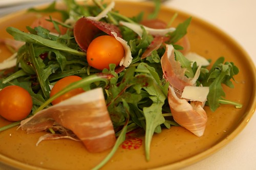 La Quercia Prosciutto with Satur Farms Arugula, Zima Tomatoes, Shaved Gruyere, and Cactus Pear Juice