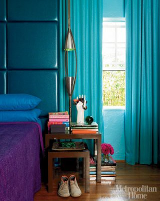 Jewel tones in the bedroom: Turquoise headboard & drapes + purple linens, from Metropolitan Home