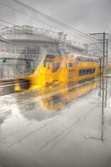 moving fast (Bas Lammers) Tags: reflection netherlands rain amsterdam train canon movement nederland arena ajax hdr regen trein beweging bijlmer reflectie photomatix 50d abigfave