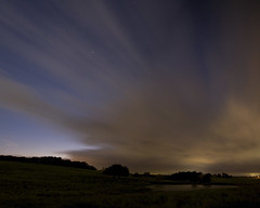 Striated Night Sky (taylorphotography) Tags: blue panorama storm night clouds canon dark stars landscape incoming canon5d 1740mm startrails