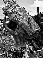 Ulingan, Tondo - Heavy, Smoky, Sweaty and Dirty Back of a Boy (Mio Cade) Tags: boy shirtless bw white black kid factory child heart labor social dirty sweaty charcoal smoky care heavy load issue carry hardship ulingan