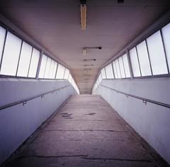 an arch-Footbridge (kymak) Tags: bridge geotagged hongkong arch footbridge naturallight velvia  fujichrome rvp100f f35 75mm tsuenwan  emptyperspective schneiderxenar3575 rolleiflex35a modelk4a automat6x6 mxtype2 geo:lat=22375575 geo:lon=11411469