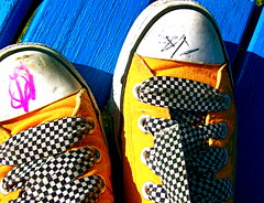 Orange Converse (Kara Allyson) Tags: orange yellow contrast toes toe converse blueandorange taxicab shoelaces conversetoes writingonshoe