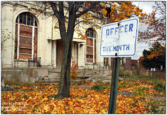 Officer Of The Month ( Abandoned Police Station in Highland Park ) (DetroitDerek Photography ( ALL RIGHTS RESERVED )) Tags: camera city november autumn urban color fall abandoned leaves station sign digital turn canon fire eos rebel hall closed cops state decay michigan urbandecay detroit police award demolition gone change law woodward xs highlandpark month legacy economy demolished 2009 department officer enclave 313 bankrupt granholm