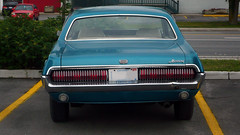 The rear of a 1968 Mercury Cougar. (Steve Brandon) Tags: auto plaza ontario canada ford car geotagged 60s parkinglot classiccar automobile mercury ottawa voiture suburb 1960s 1968 nepean cougar  coupe sixties musclecar stripmall sportscar 68 ponycar stationnement  americancar mercurycougar       fordmotorcompany  merivaleroad  merivalerd  merivalemarket ruemerivale cheminmerivale