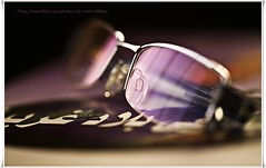 Reading (N02) Tags: macro canon reading glasses book mark ii 5d  180mm       canonef180mmf35lmacrousm