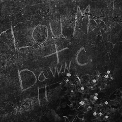 Lou M + Dawn C (lydiafairy) Tags: blackandwhite bw building abandoned love water wall concrete 50mm graffiti washington dock nikon decay neglected dirty tacoma chipped cracked ruston dirtywall d80 loudawn
