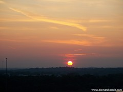 Hazy Sunset Scene in Bismarck, North Dakota (BismarckPride.com) Tags: sunset red sky sun color haze cloudy scene northdakota hazy bismarck mandan missouririver
