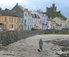 walking the dog... (jackeeadio) Tags: ireland houses dog man seaweed cars beach beard candid northernireland wellingtonboots moat ulster donaghadee countydown terracedhouses