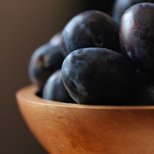 Plums in a bowl in the light by lepiaf.geo.