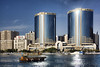 Rolex Towers, Dubai Creek (sminky_pinky100 (In and Out)) Tags: travel blue building tourism water architecture boats dubai uae sunny dubaicreek udo soe shimmer dhow bej abigfave omot rolextowers eyejewel deiratwintowers