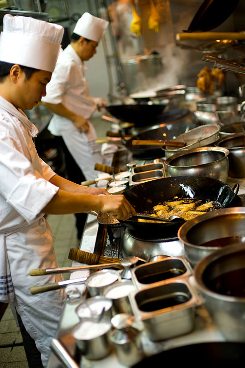 Chefs at work in the kitchen of the InterContinental Hong Kong's Chinese restaurant
