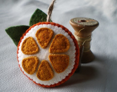orange you glad? (lilfishstudios) Tags: orange recycled handmade sewing craft ornament handsewn lilfishstudios feltedwoolsweater