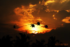 Sunset with Sarang (Vinod Kumar M.) Tags: sunset sky sunlight india nature clouds canon evening kerala canon350d helicopters airforce sarang vino vinod indianairforce sigma70300mmf456 thripunithura vinodkumar vinodkumarmphotography