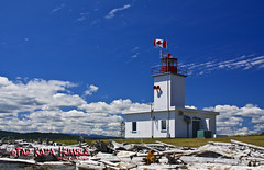 Pulteney Point Lighthouse (Ki'i O' Kapa) Tags: lighthouse canada building architecture clouds bc earth structure malcolmisland kiiokapa tadkapahumble pulteneypoint