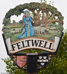 Feltwell Village Sign (eaglekepr) Tags: flowers trees plants dog building tree church sign architecture lady cat suffolk paw village cross sheep unitedkingdom wildlife norfolk shield canoneos30d ef24105mmf4lisusm feltwell vsgroup vsset