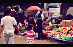 """I think I want that one.."" (khaniv13) Tags: people girl walking children daddy 50mm zoo nikon colorful dolls f14 candid father snapshot together jakarta manualfocus ragunan d40x ilikeshootingpeople khaniv13 ihopetheydontmindtheirpicturesbeingtaken"